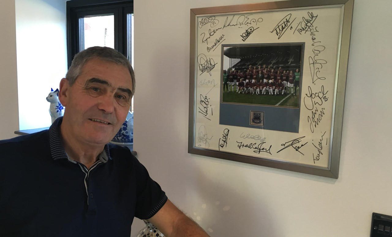 Carr in front of a signed picture of West Ham-academy players. Photo: Simon Hart