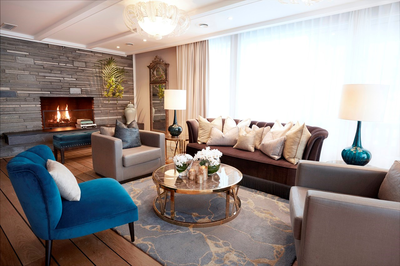 Living area with fireplace in the Grand Penthouse Terrace Suite
